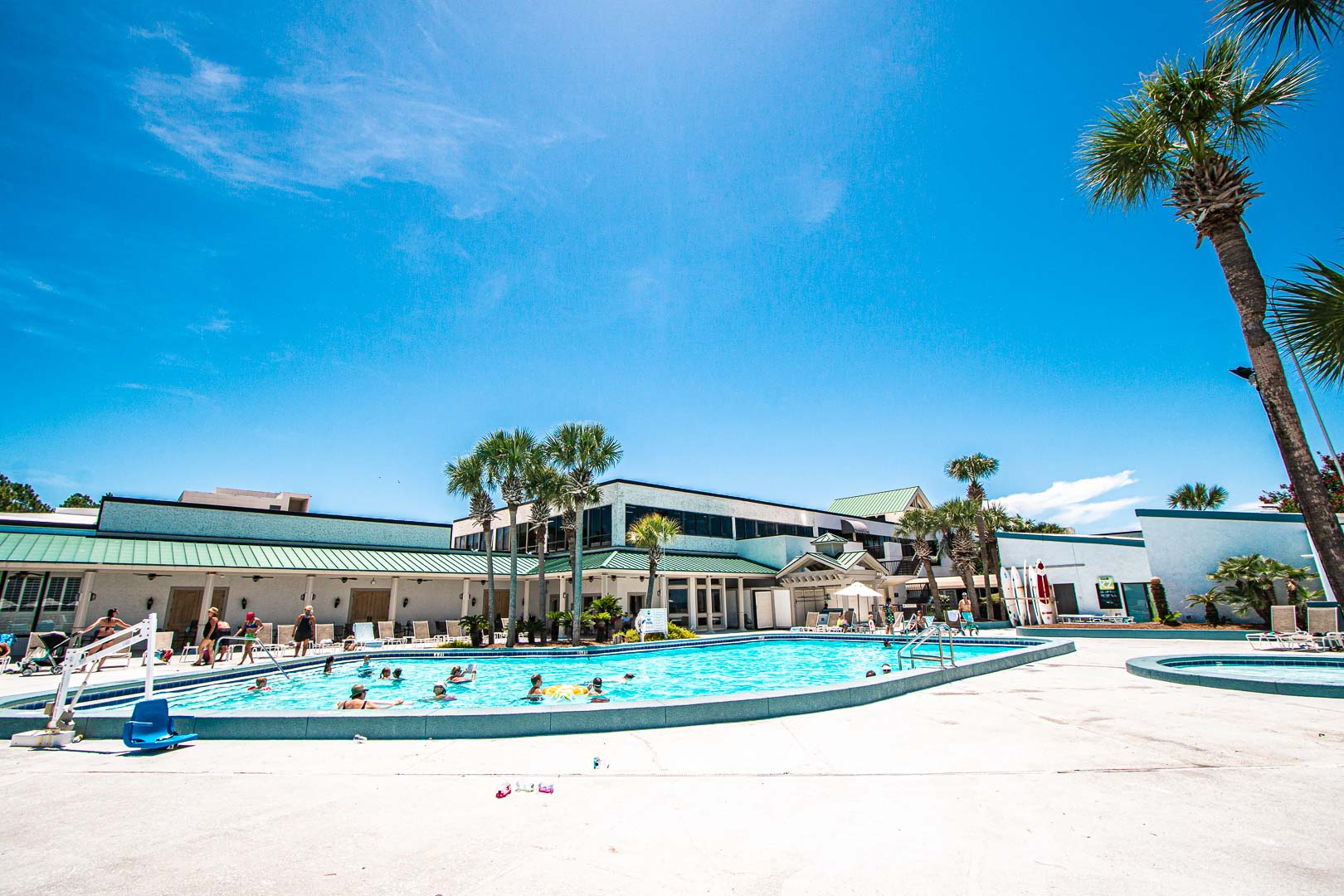 A scenic view of the outdoor swimming pool at VRI's Bay Club of Sandestin in Florida.