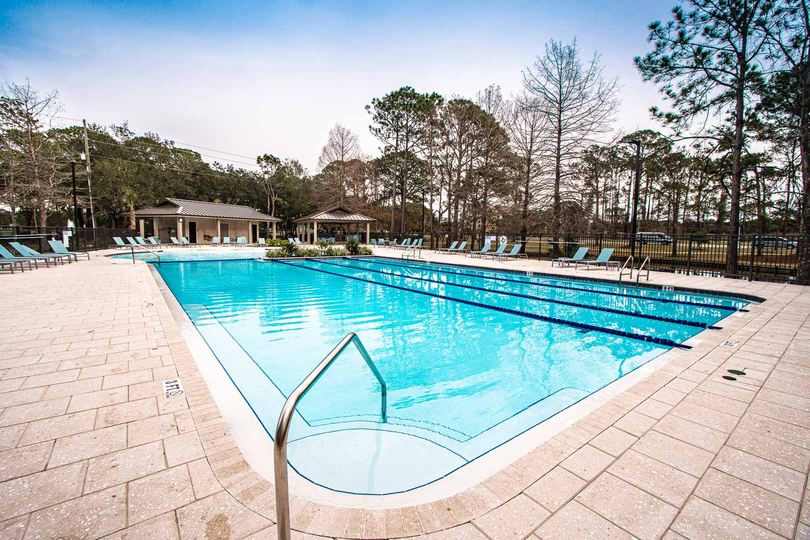 An expansive outdoor swimming pool at VRI's Bay Club of Sandestin in Florida.