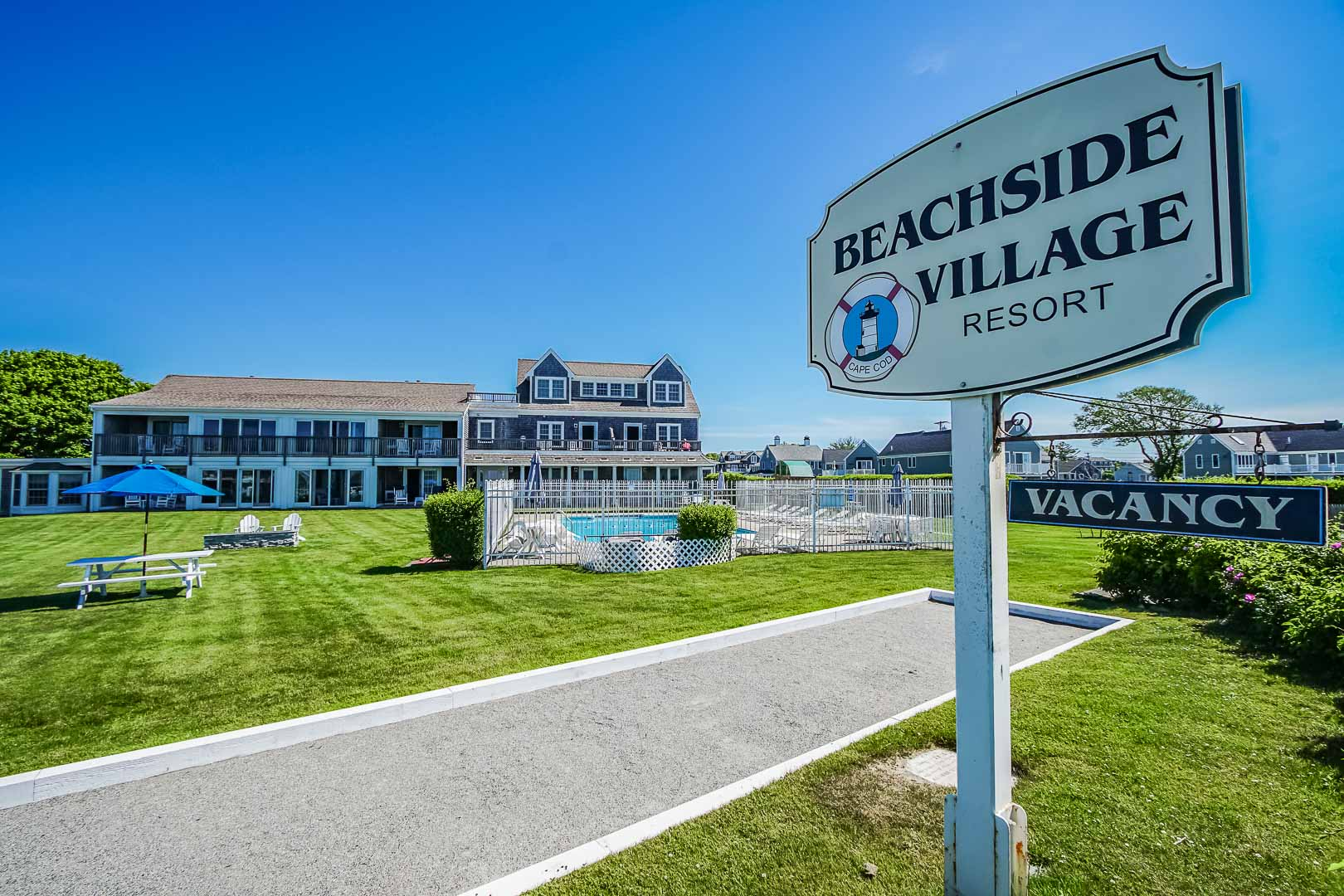 A welcoming resort entrance at VRI's Beachside Village Resort in Massachusetts.