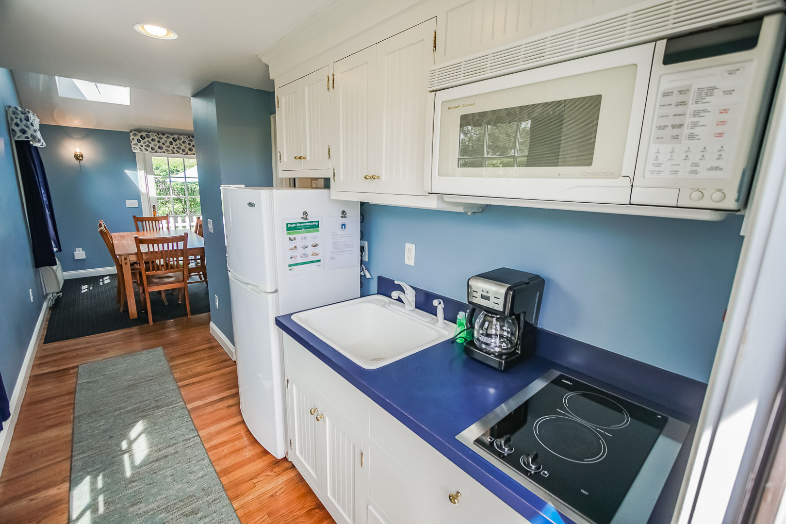 A standard full kitchen at VRI's Beachside Village Resort in Massachusetts.