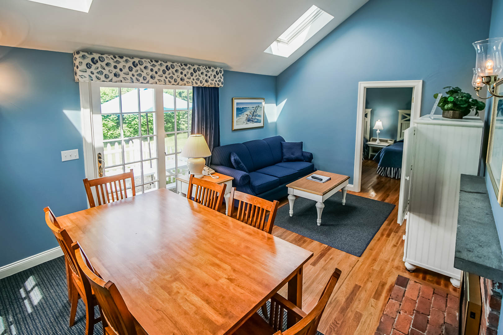 An expansive 1 bedroom with dining and living room area at VRI's Beachside Village Resort in Massachusetts.