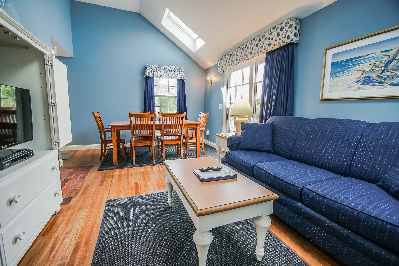 A spacious living room area at VRI's Beachside Village Resort in Massachusetts.