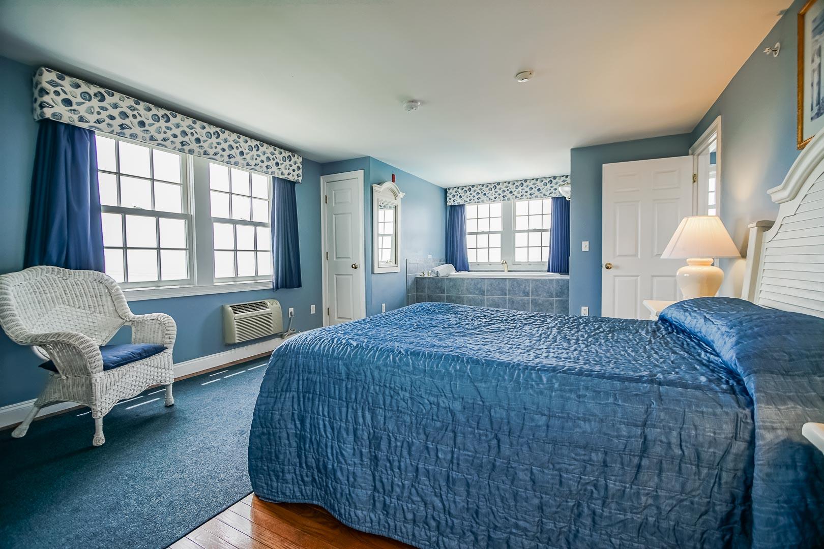 A spacious bedroom at VRI's Beachside Village Resort in Massachusetts.