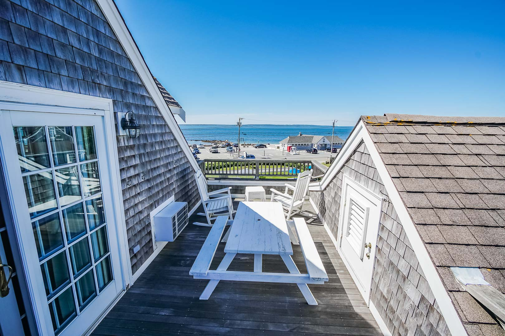 A serene beach view from the balcony at VRI's Beachside Village Resort in Massachusetts.