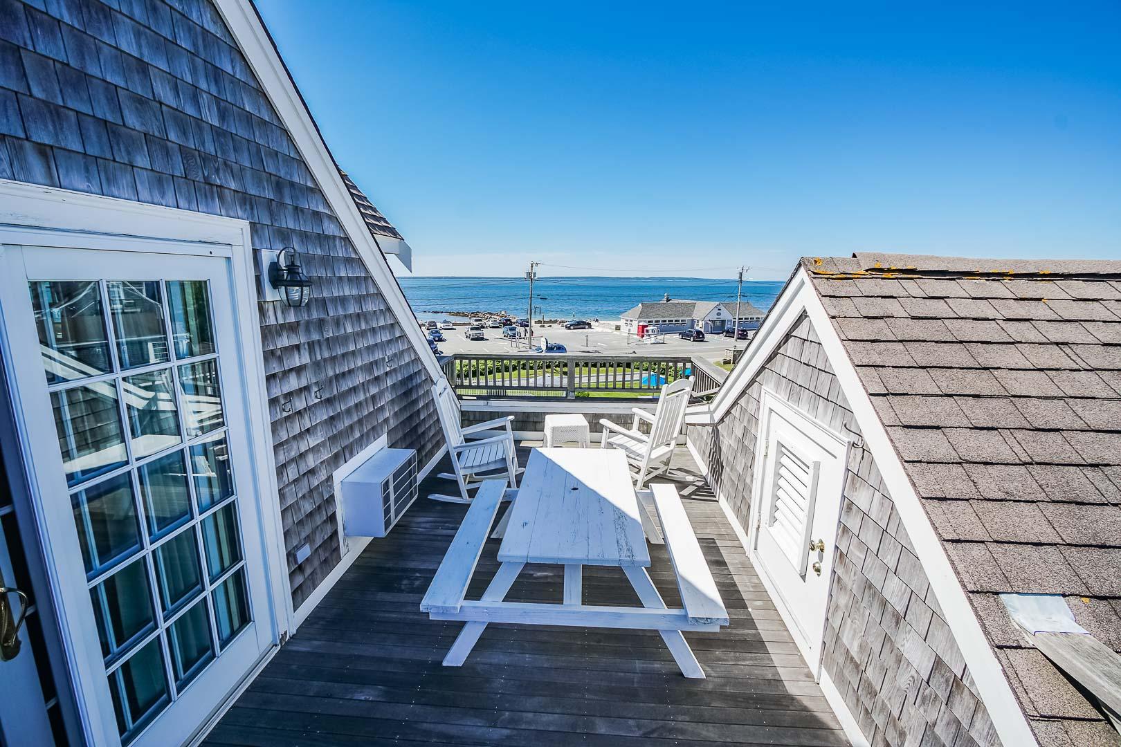 A serene beach view from the balcony at VRI's Beachside Village Resort in Massachusetts.