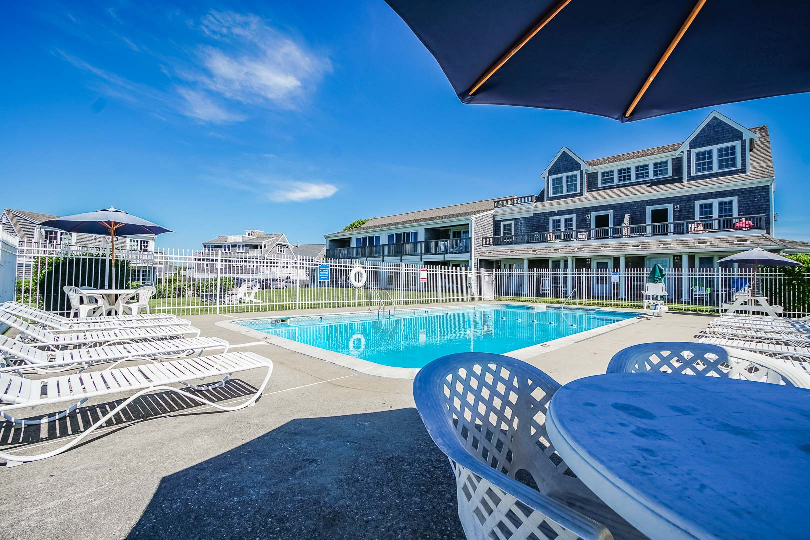 A refreshing pool at VRI's Beachside Village Resort in Massachusetts.