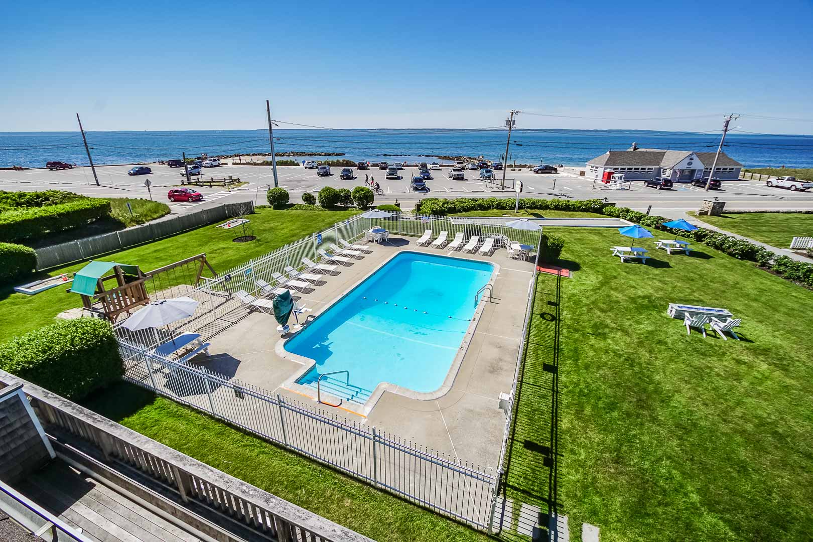 A scenic view of the pool at VRI's Beachside Village Resort in Massachusetts.