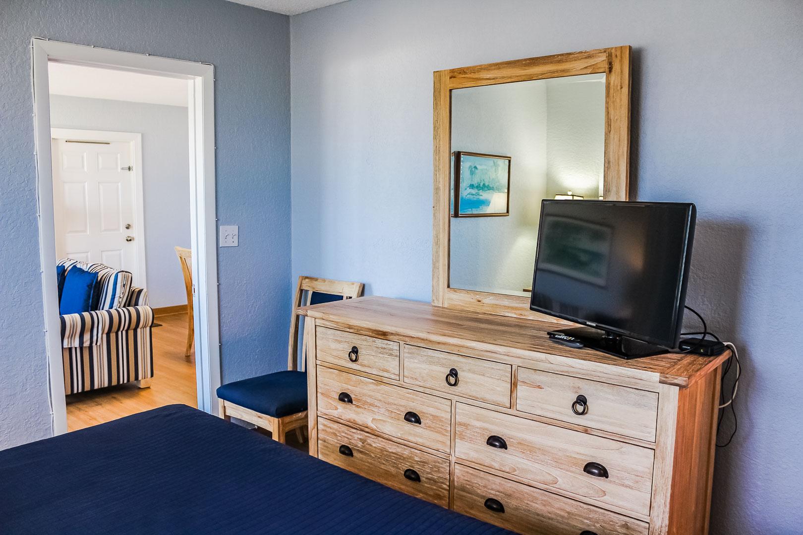 A quaint master bedroom unit at VRI's Berkshire Beach Club in Florida