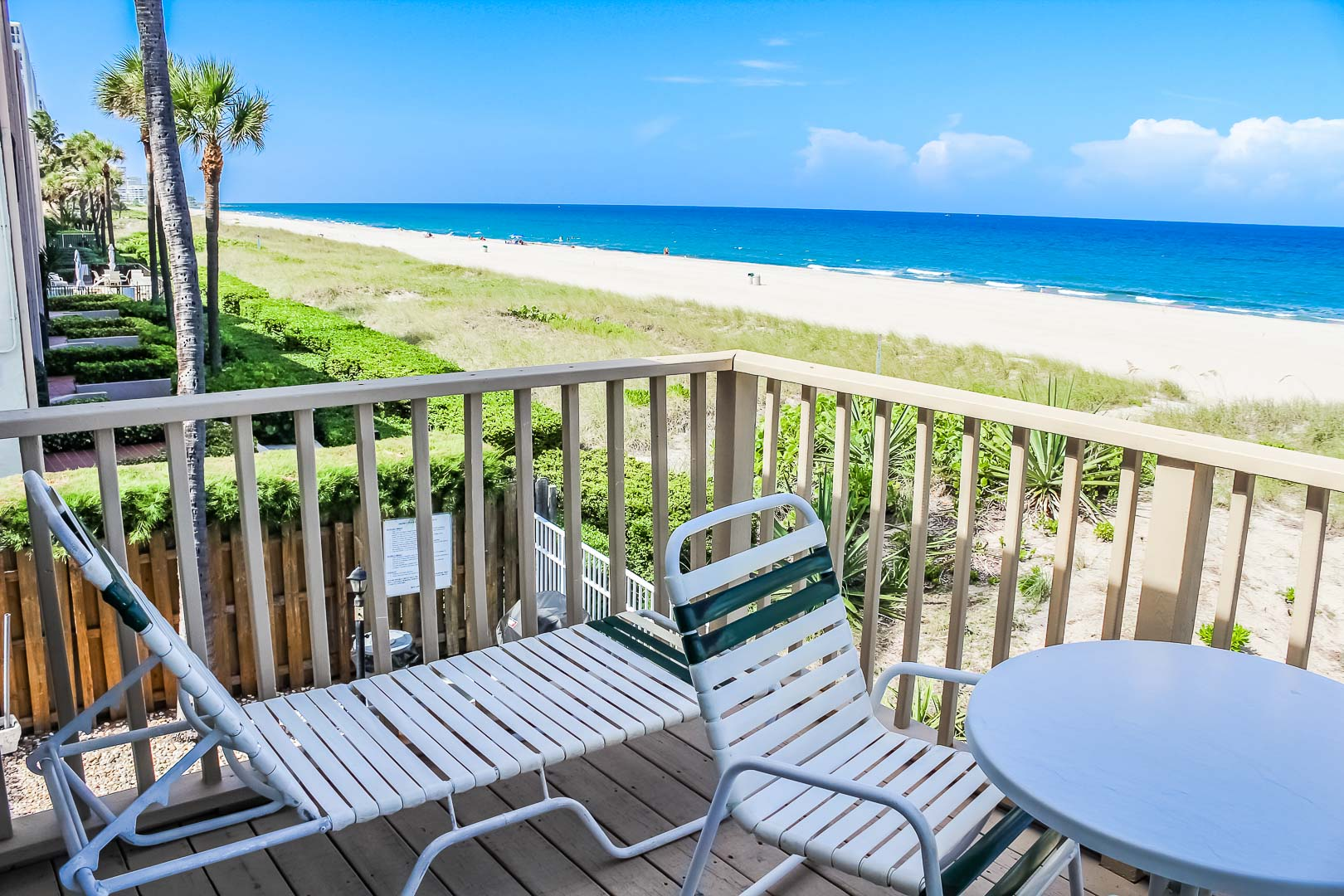 A relaxing balcony deck with a beach view at VRI's Berkshire Beach Club in Florida