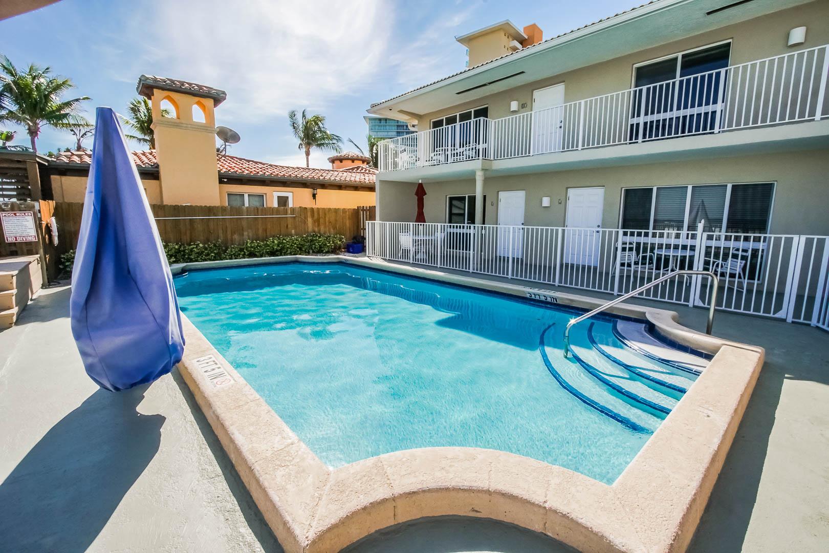A refreshing pool at VRI's Berkshire Beach Club in Florida