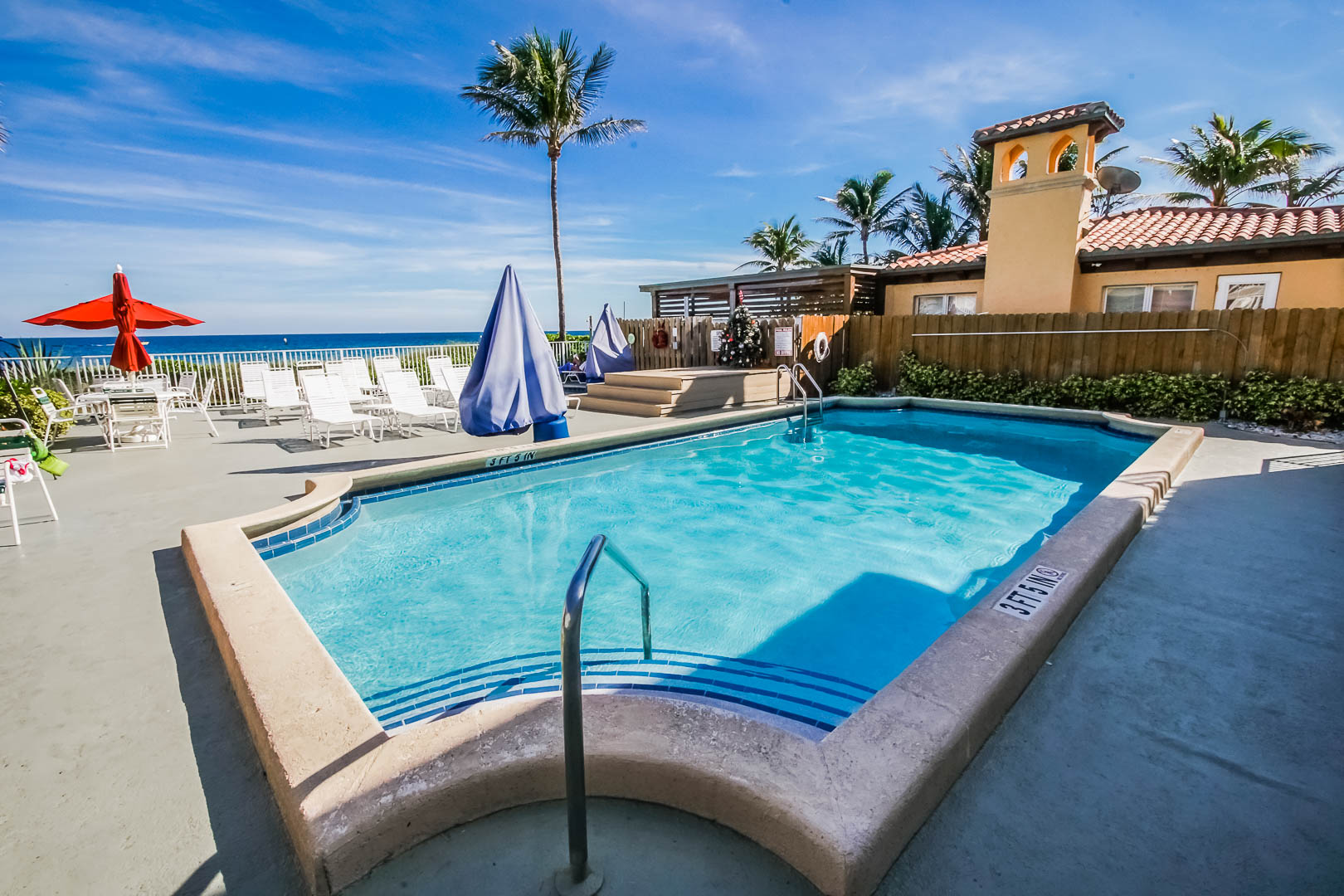 A refreshing pool with an ocean view at VRI's Berkshire Beach Club in Florida