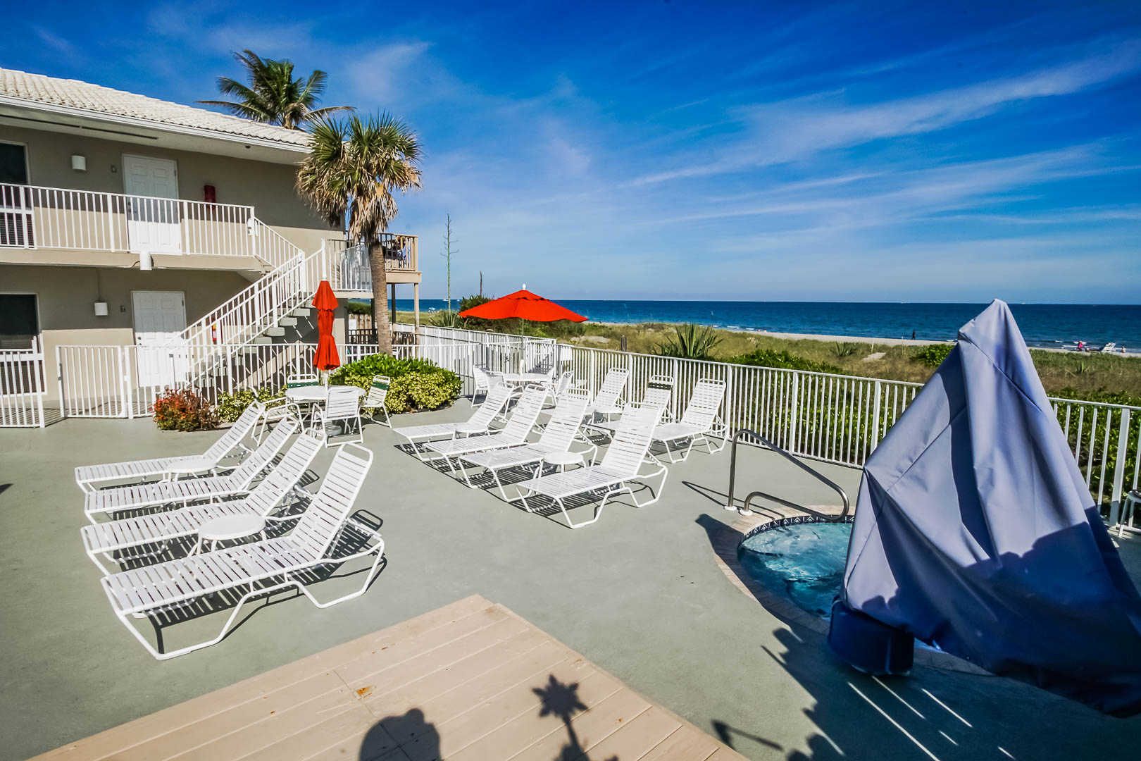 a relaxing view of the poolside at VRI's Berkshire Beach Club in Florida