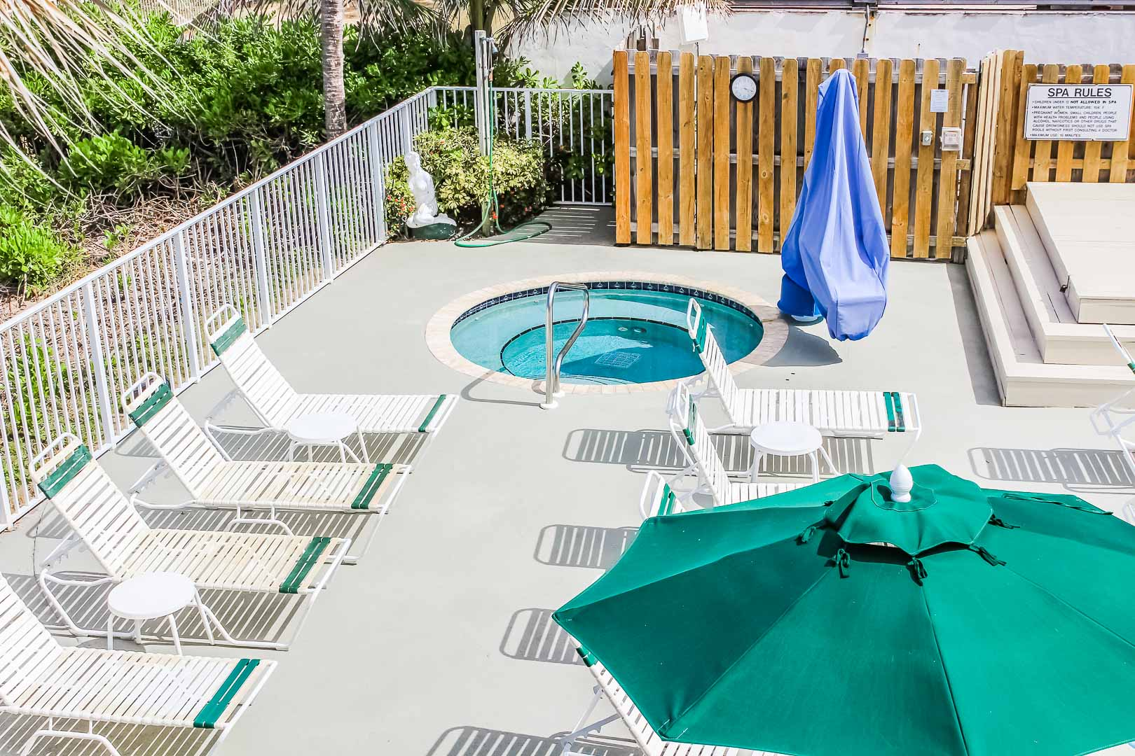 A quaint jacuzzi with tanning area at VRI's Berkshire Beach Club in Florida