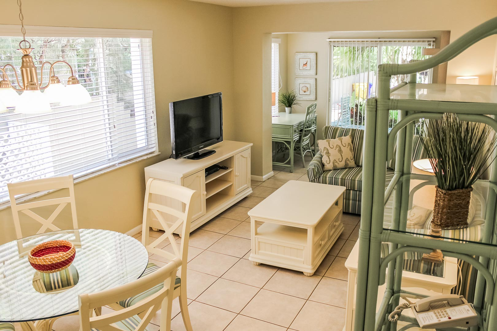 A pleasant living and dining area at VRI's Berkshire by the Sea in Florida.
