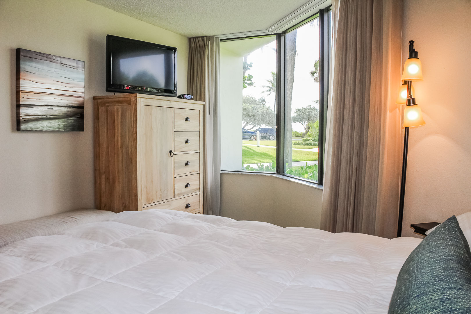 A beautiful master bedroom at VRI's Berkshire by the Sea in Florida.