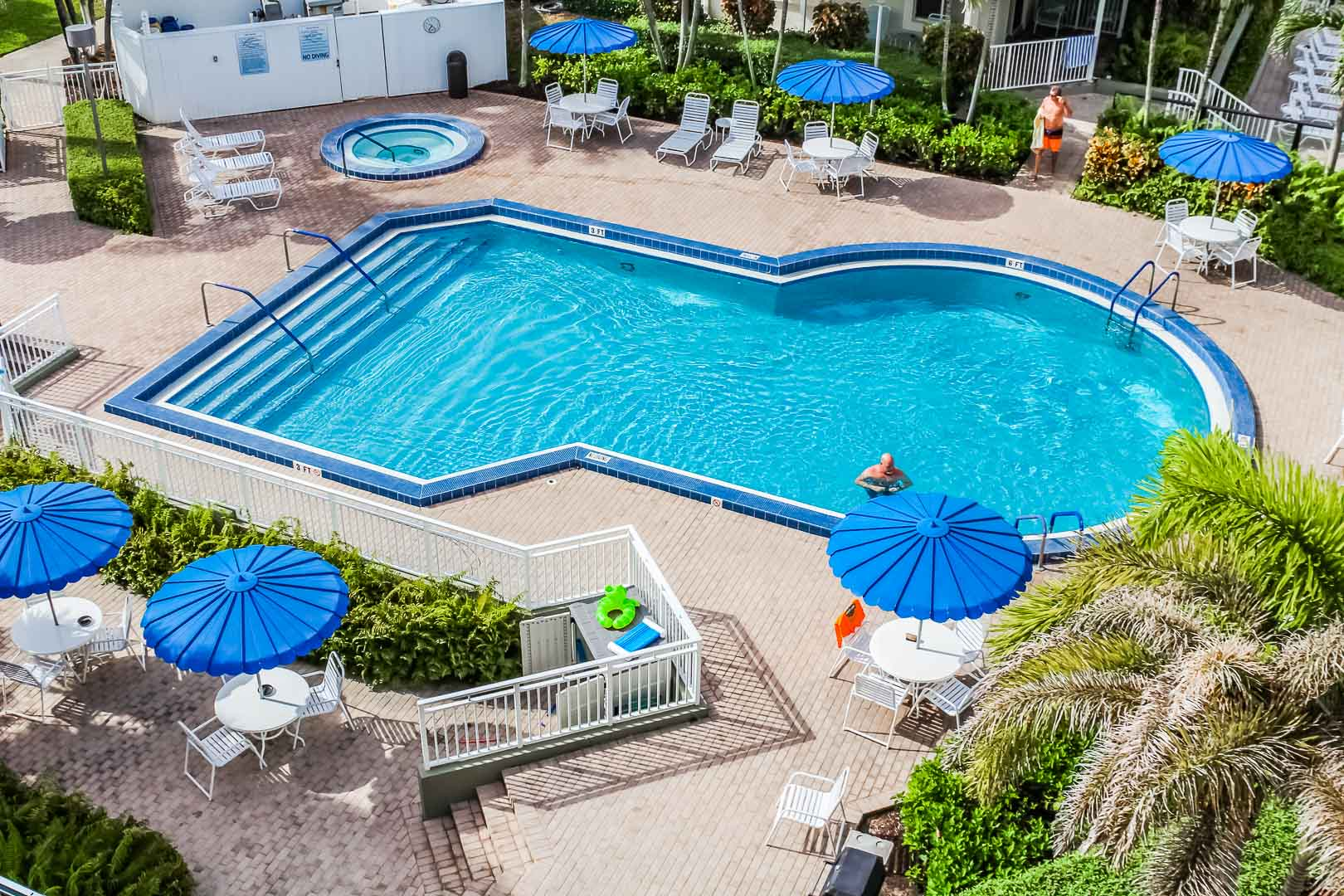 A refreshing pool and jacuzzi at VRI's Berkshire by the Sea in Florida.