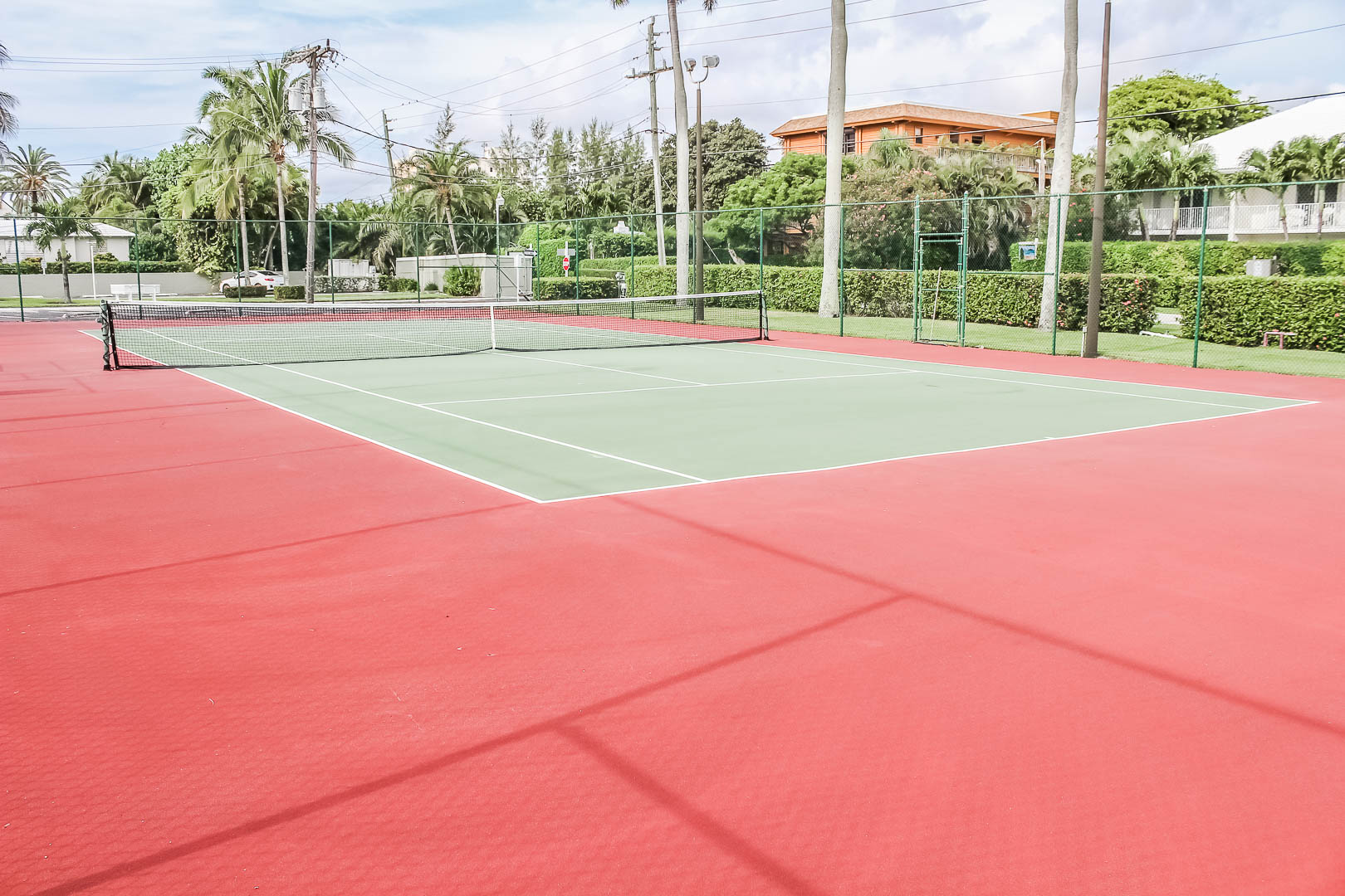 An expansive tennis court at VRI's Berkshire by the Sea in Florida.