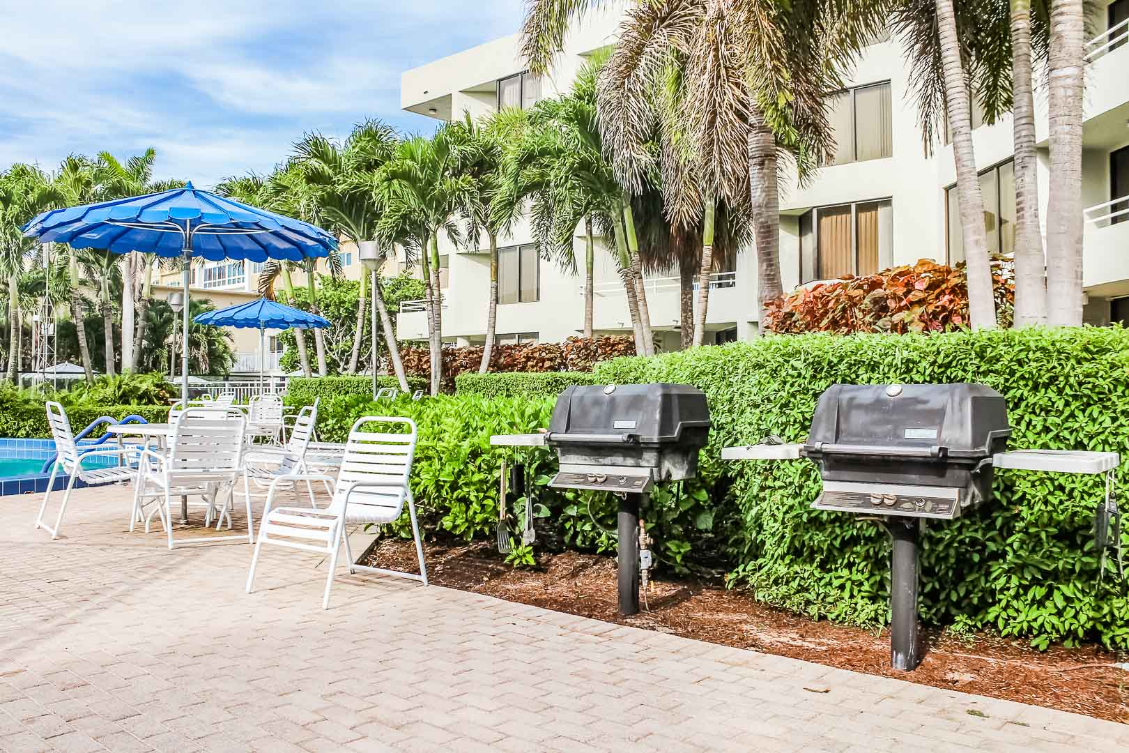 A pleasant pool area with BBQ Grills at VRI's Berkshire by the Sea in Florida.