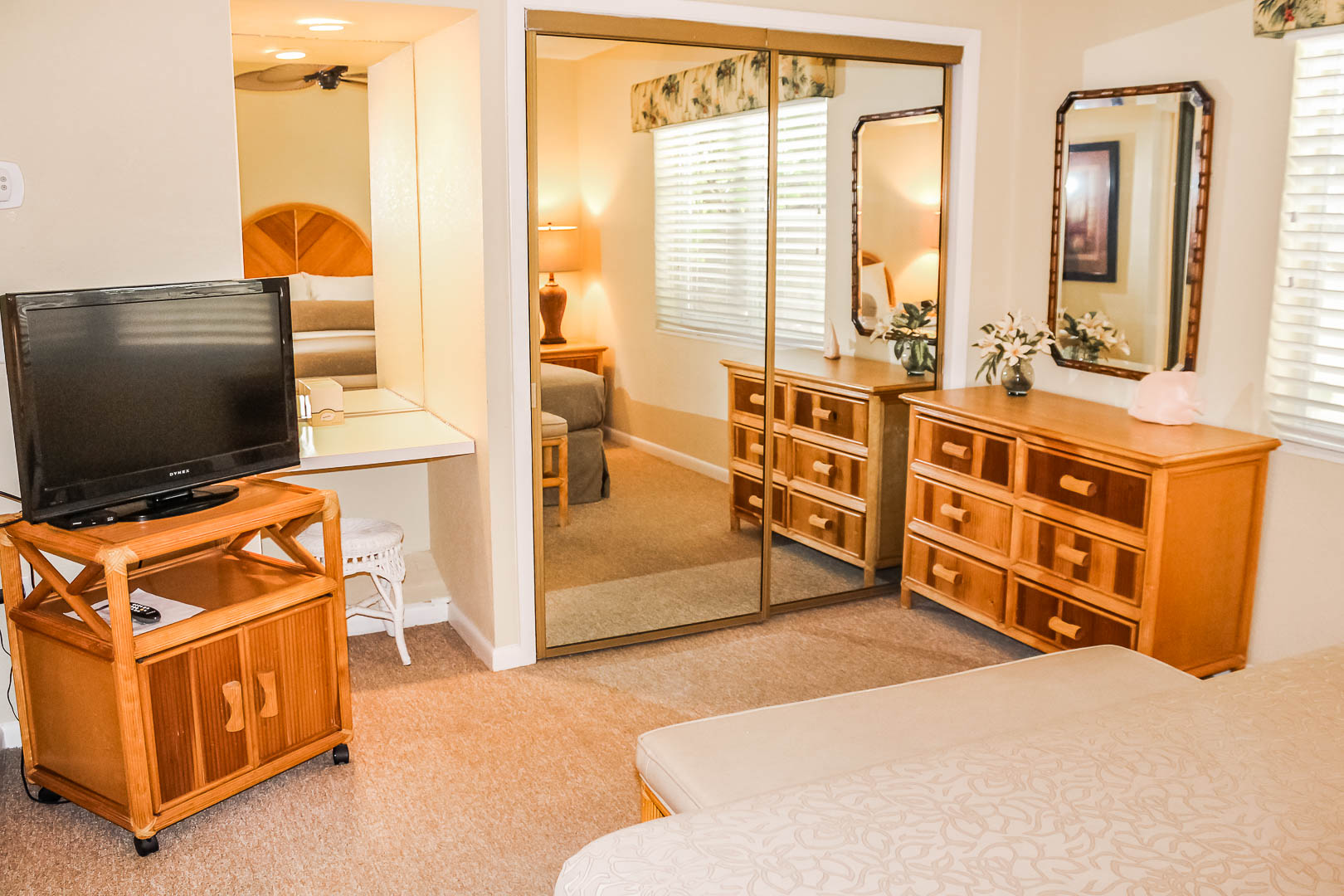 A cozy bedroom at VRI's Berkshire on the Ocean in Florida.