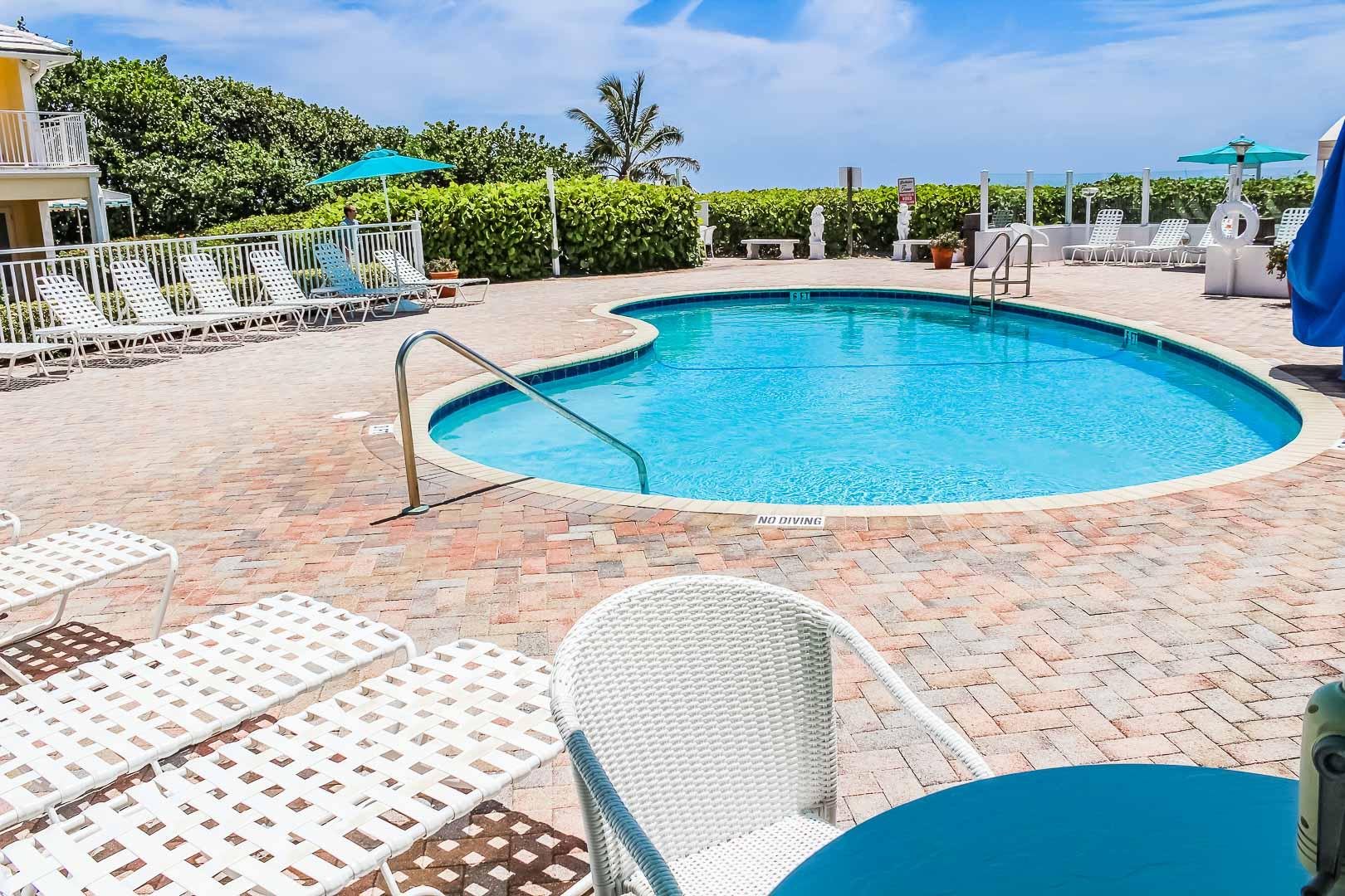 A crisp swimming pool at VRI's Berkshire by the Ocean in Florida.