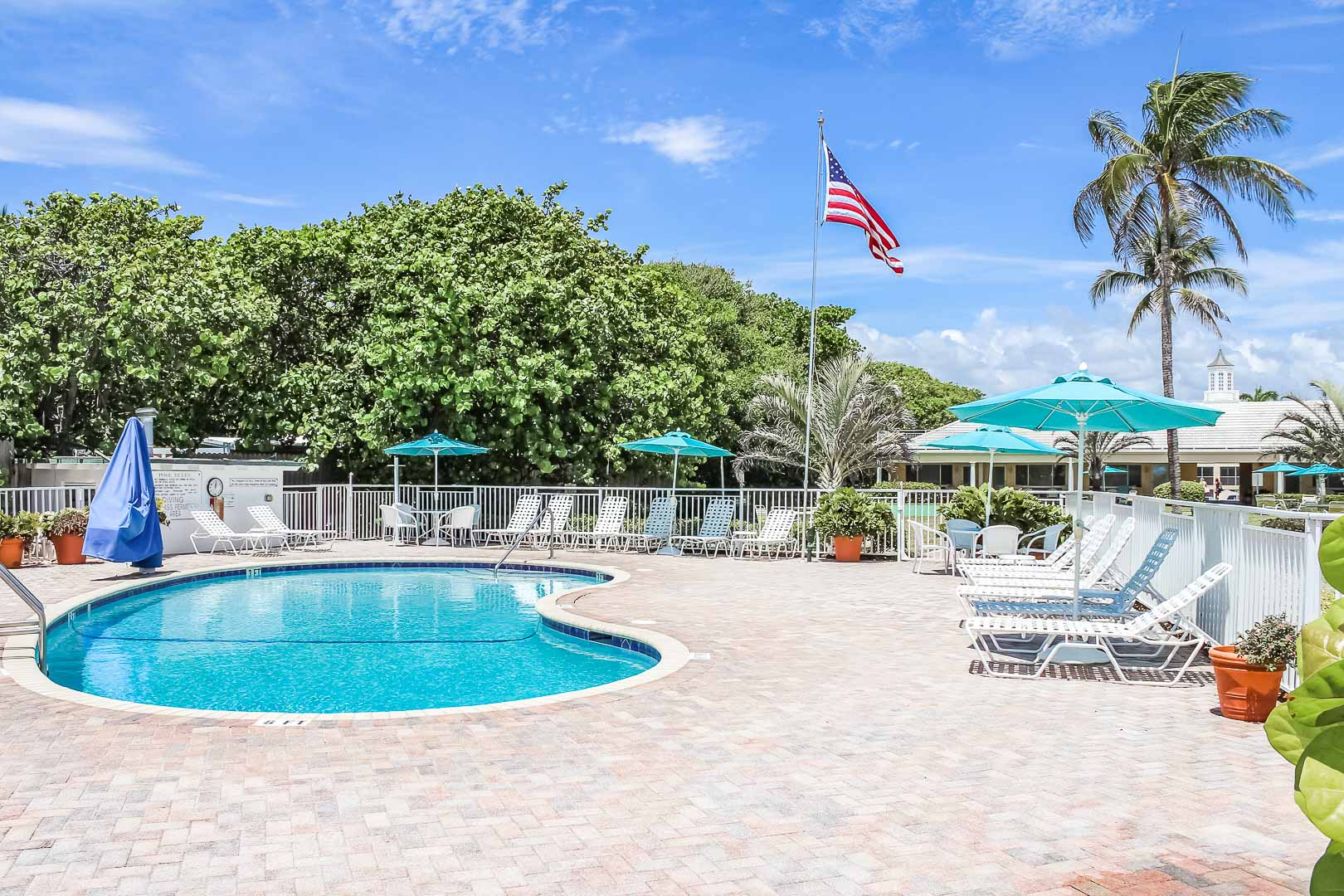 A refreshing swimming pool at VRI's Berkshire on the Ocean in Florida.