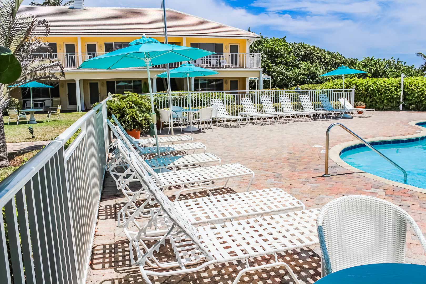 A relaxing swimming pool at VRI's Berkshire on the Ocean in Florida.