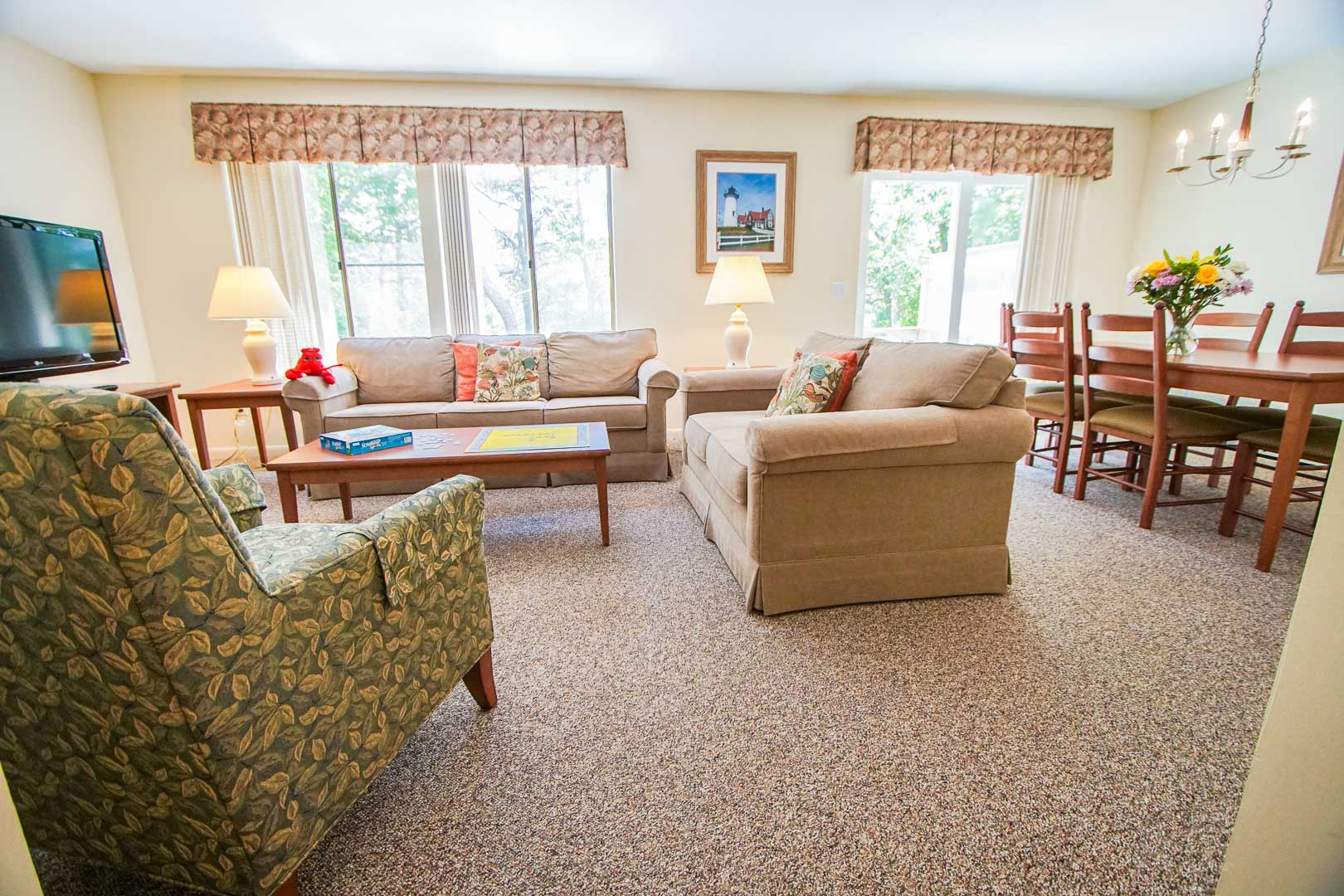 A cozy living and dining room area at VRI's Brewster Green Resort in Massachusetts.