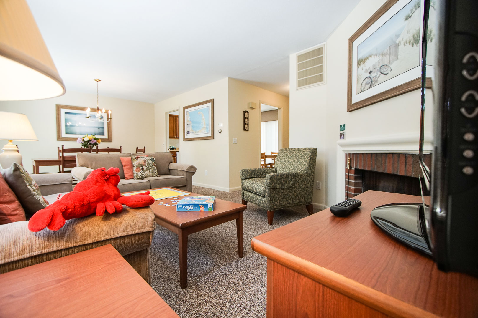 A cozy and spacious living room area at VRI's Brewster Green Resort in Massachusetts.