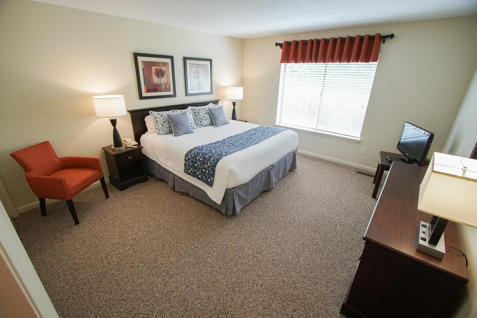 A spacious master bedroom at VRI's Brewster Green Resort in Massachusetts.