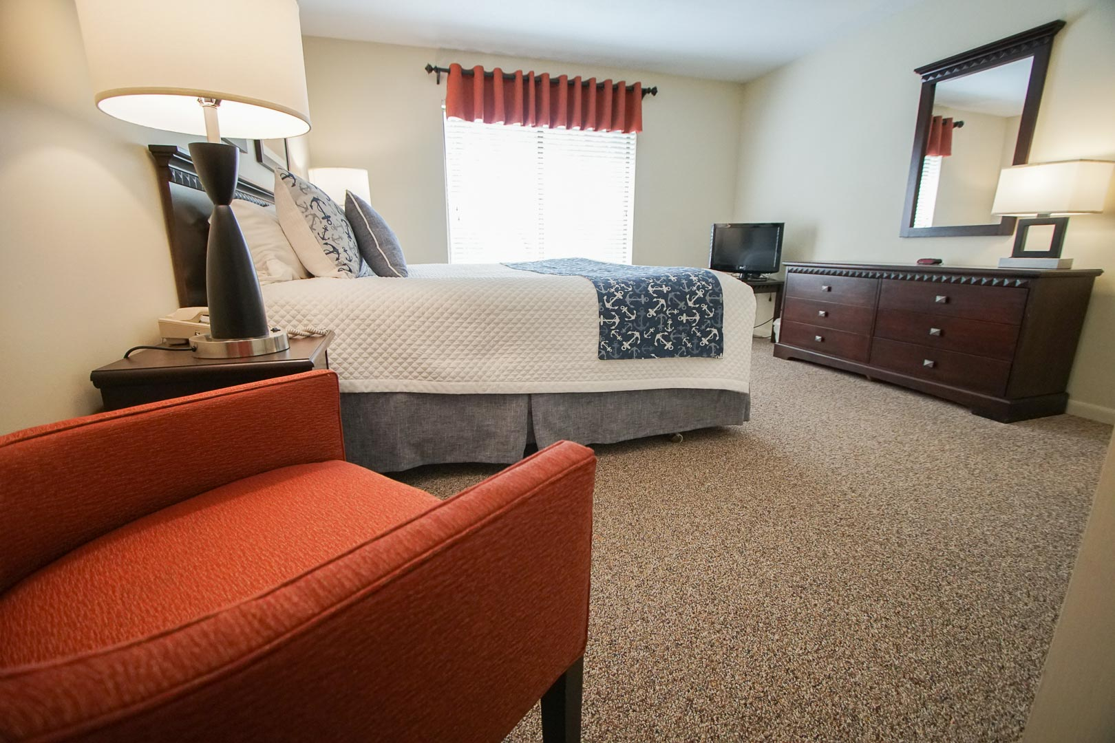 Spacious master bedroom accommodations available at VRI's Brewster Green Resort in Massachusetts.