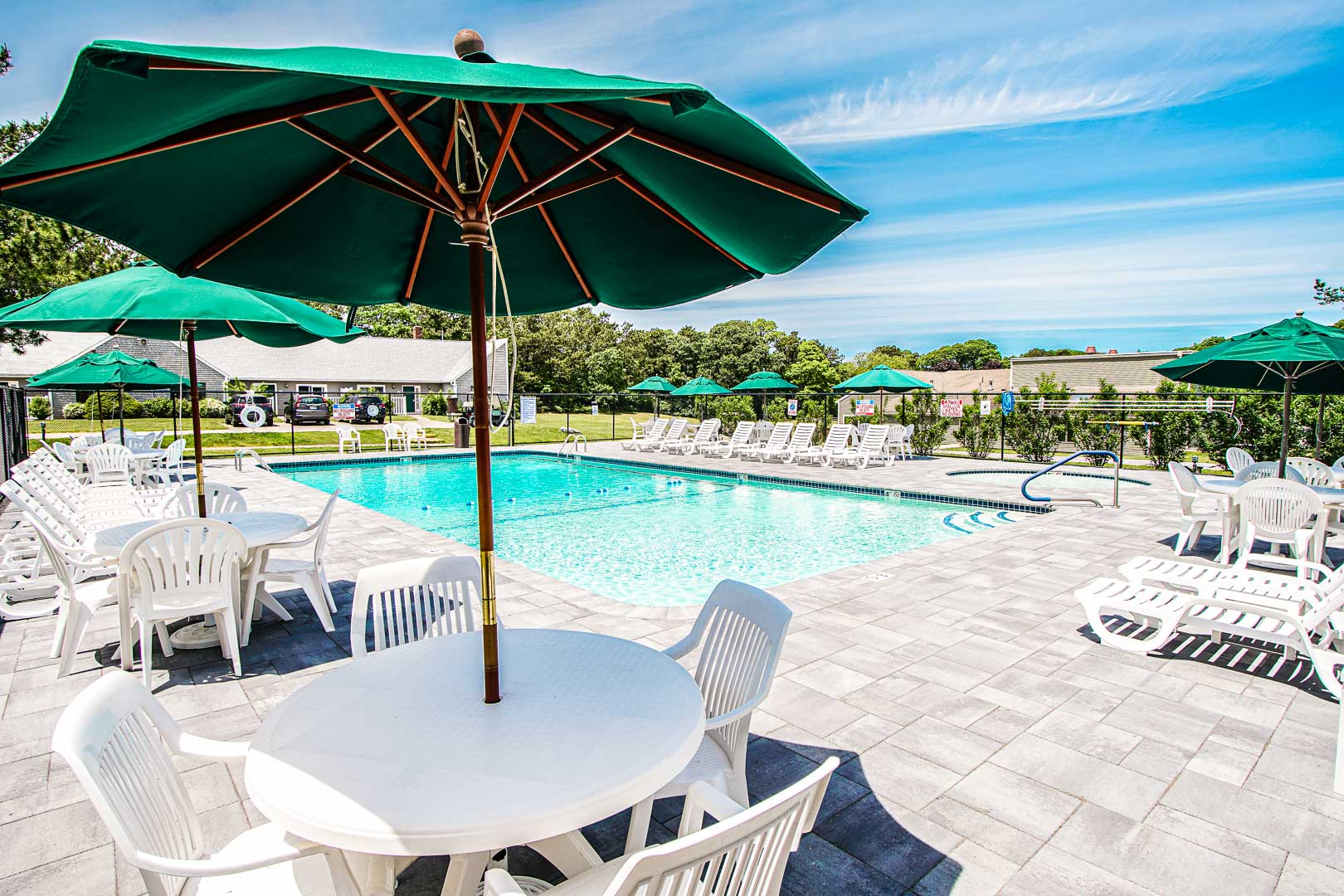 A relaxing swimming pool area at VRI's Brewster Green Resort in Massachusetts.
