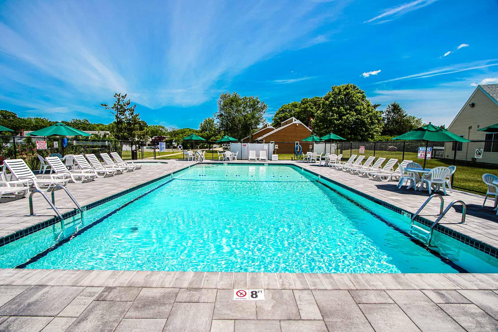 A crisp outdoor swimming pool at VRI's Brewster Green Resort in Massachusetts.
