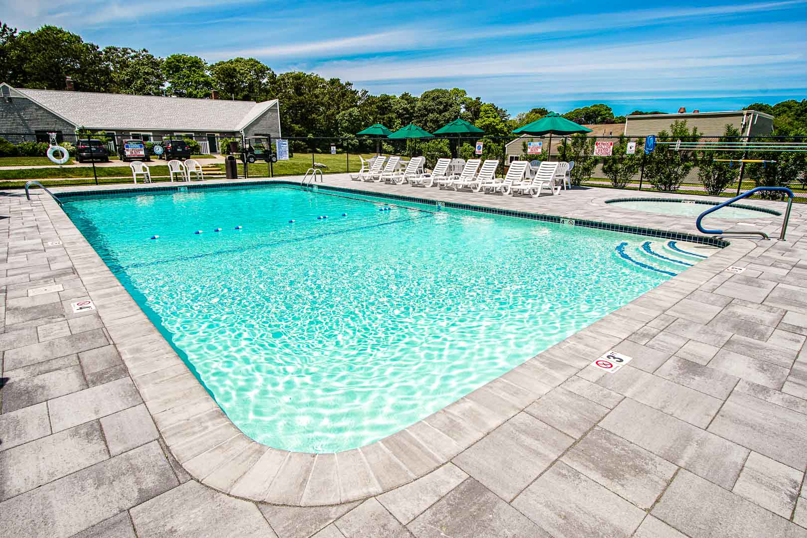 A crisp and clean outdoor swimming pool at VRI's Brewster Green Resort in Massachusetts.