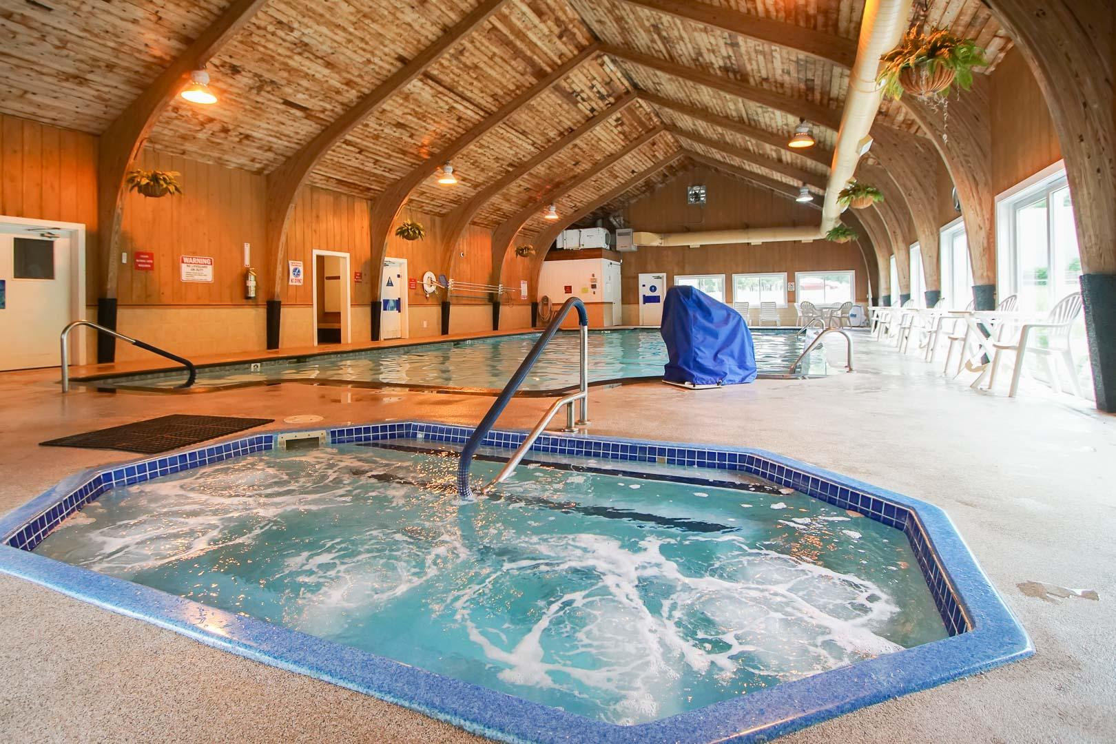 A cozy indoor Jacuzzi at VRI's Brewster Green Resort in Massachusetts.