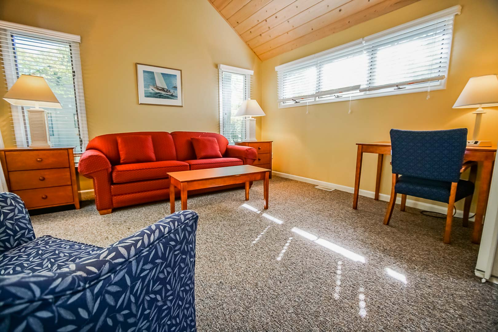 A traditional living room area and a personal size desk at VRI's Cape Cod Holiday Estates in Massachusetts.