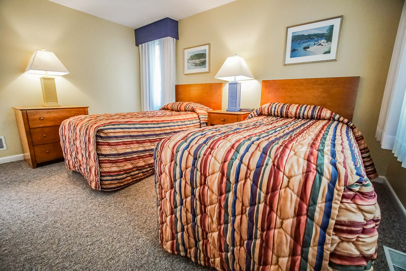 A two bedroom unit with double beds available at VRI's Cape Cod Holiday Estates in Massachusetts.