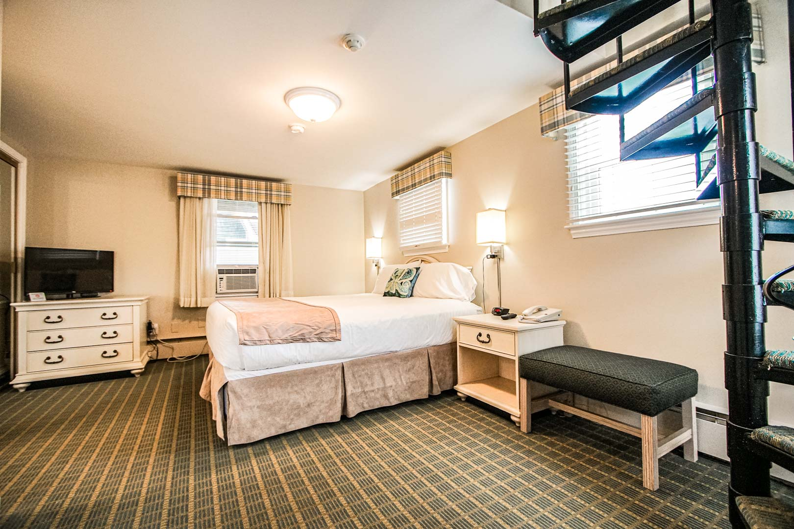 An ample master bedroom with a loft at VRI's Cape Winds Resort in Massachusetts.