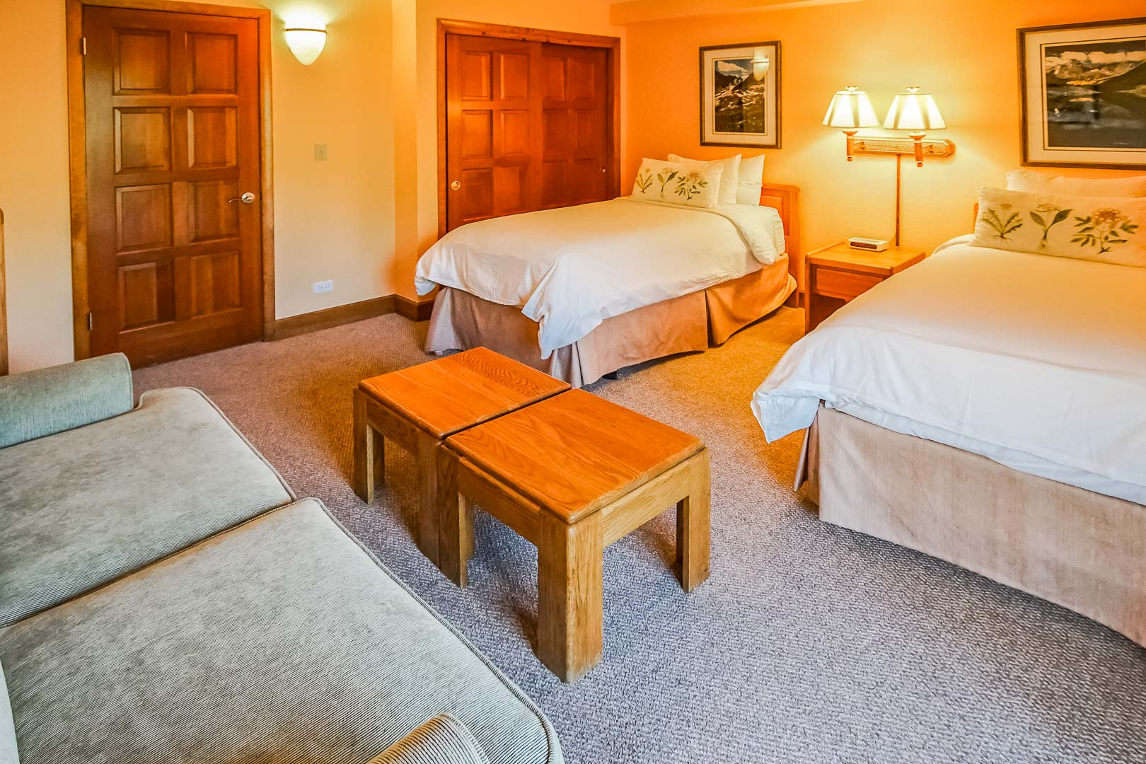 A spacious bedroom with double beds at VRI's Cedar at Streamside in Colorado.