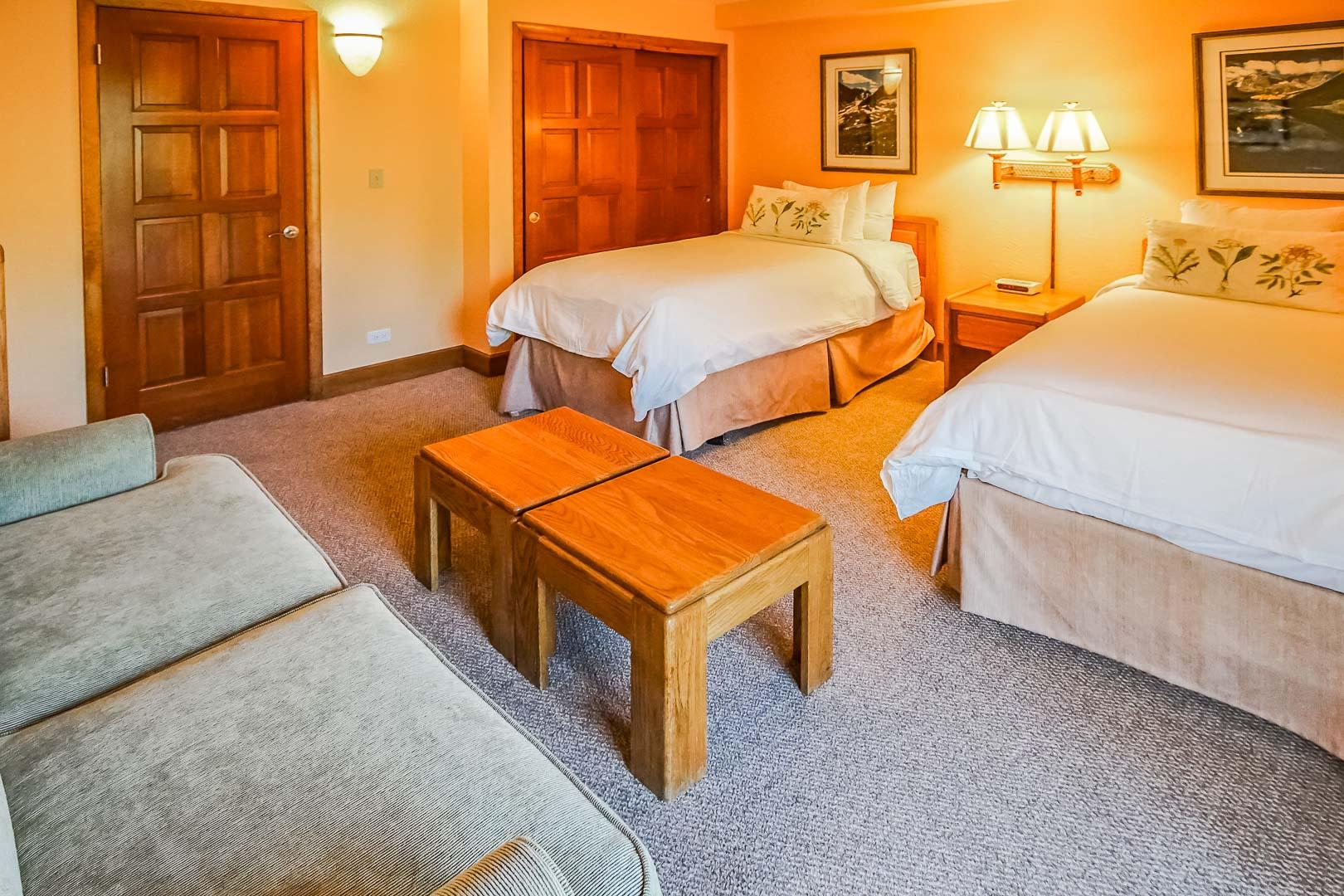 A spacious bedroom with double beds at VRI's Cedar at Streamside in Colorado.