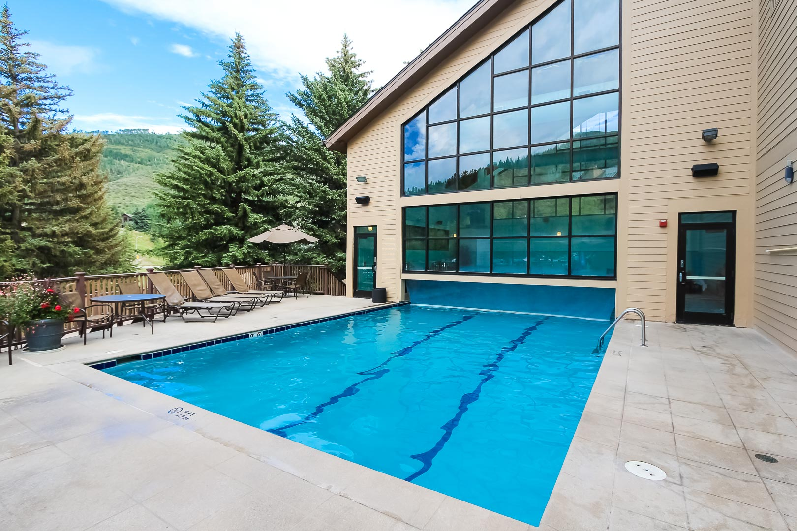 A peaceful outdoor swimming pool with a view at VRI's Cedar at Streamside in Colorado.