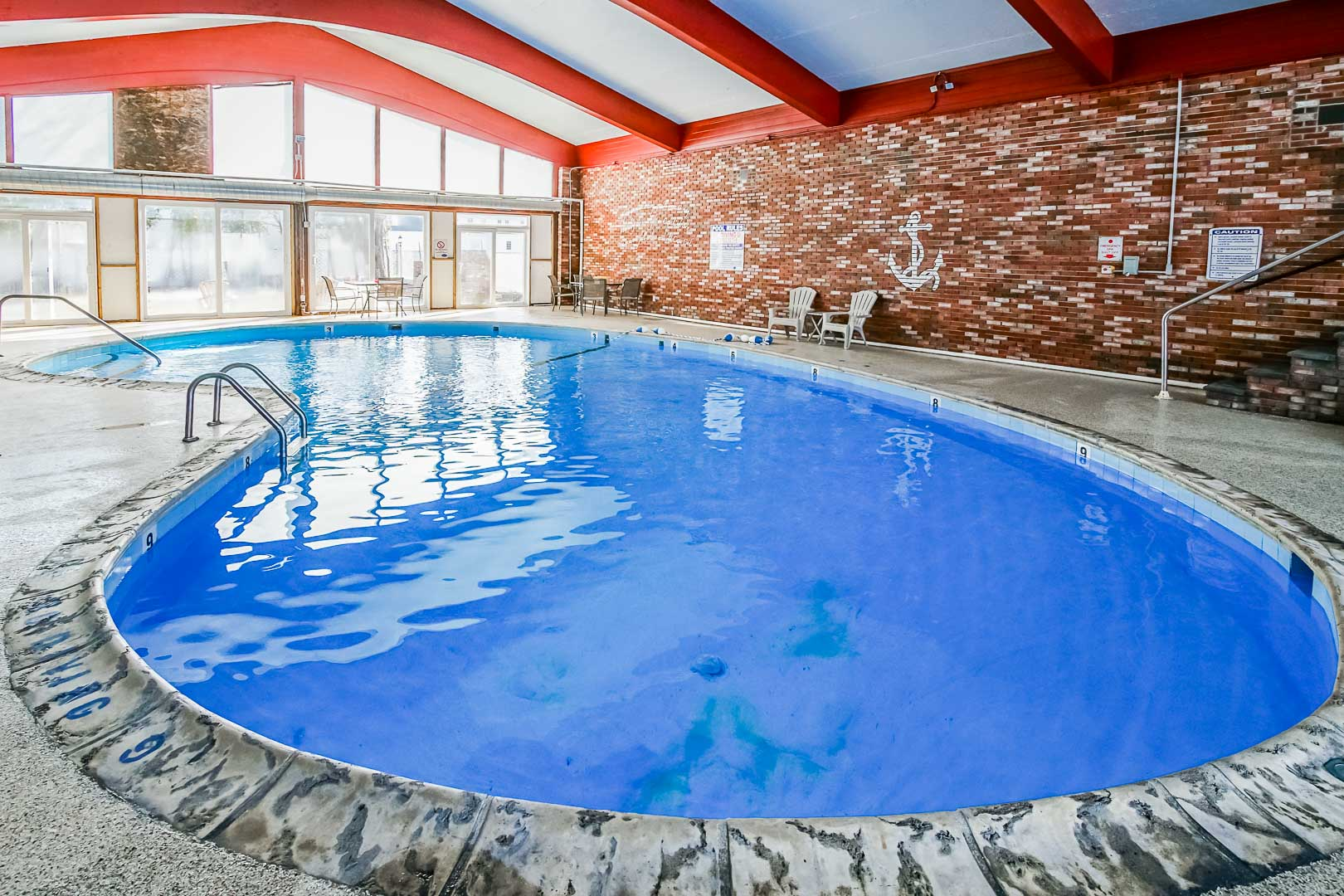 A crisp and clean indoor swimming pool at VRI's Courtyard Resort in Massachusetts.