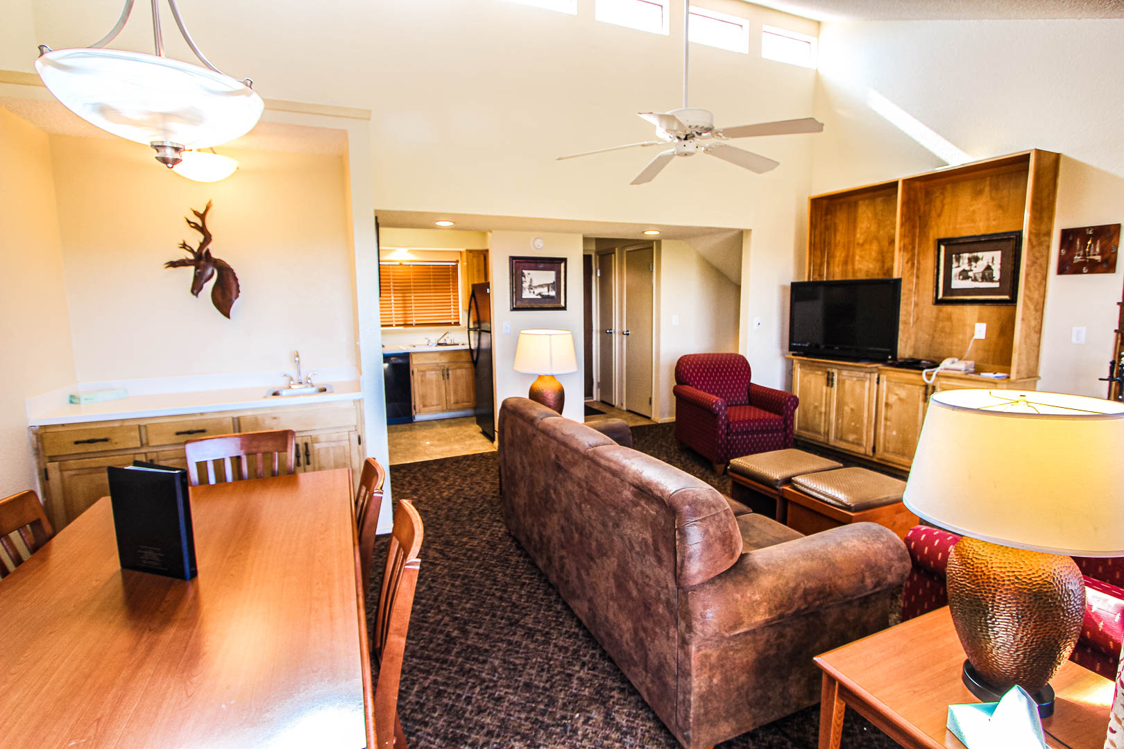 A roomy living and dining room area at VRI's Crown Point Condominiums in New Mexico.