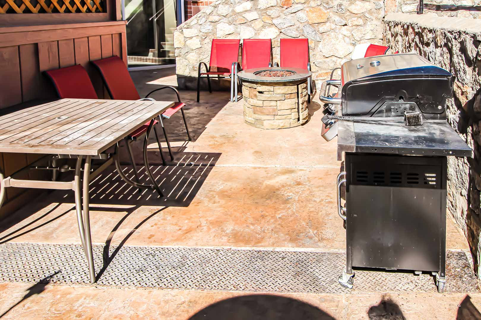 A BBQ grill area with bonfire pit at VRI's Crown Point Condominiums in New Mexico.