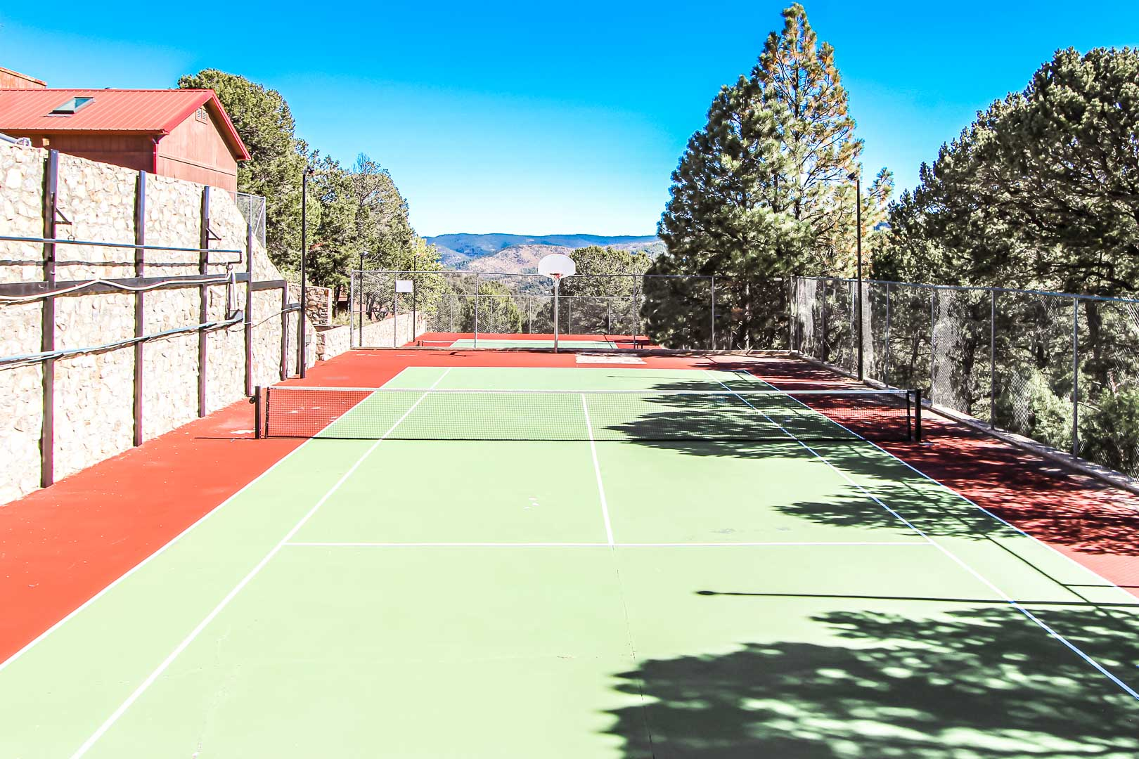 An ample view of the tennis courts at VRI's Crown Point Condominiums in New Mexico.