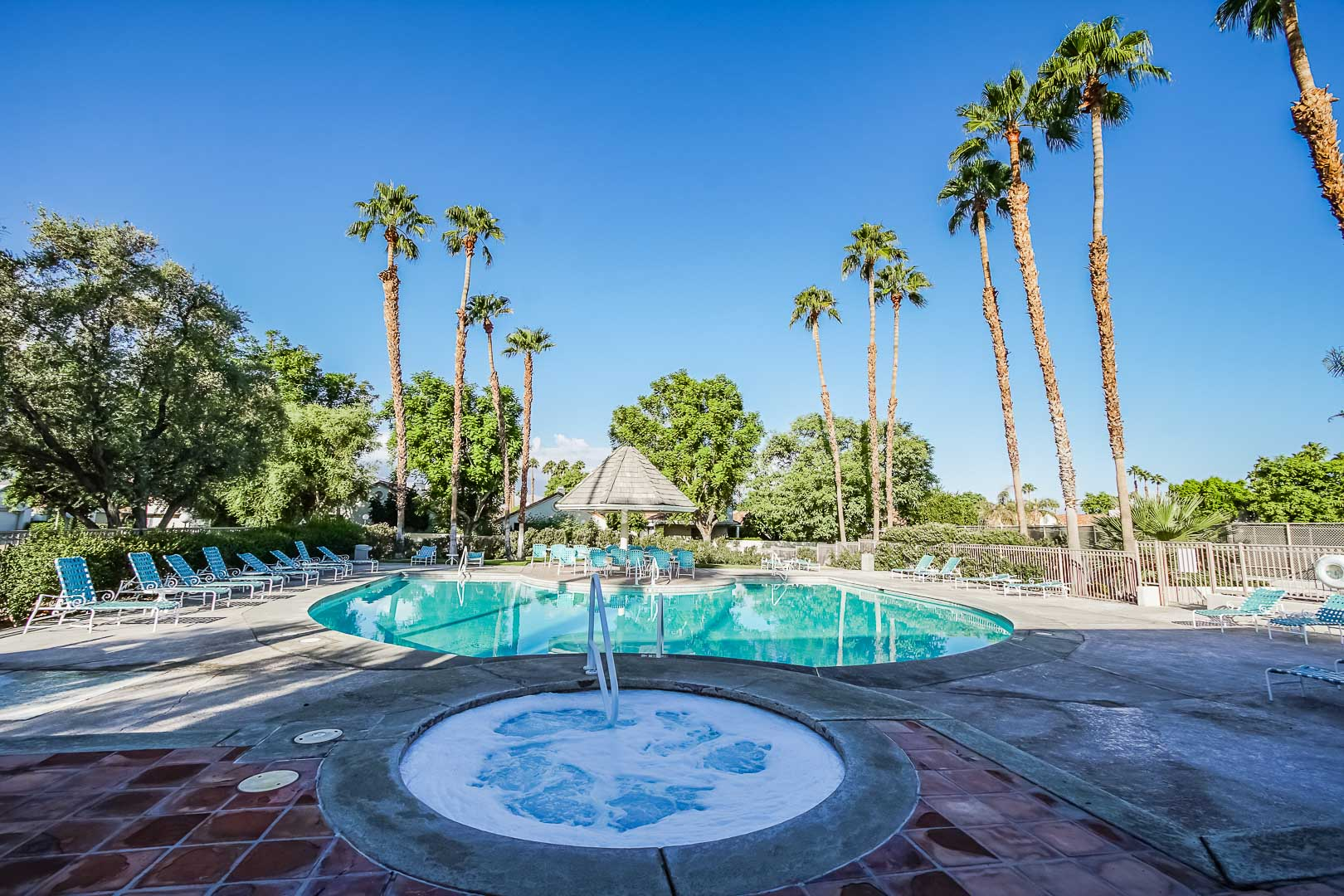 A scenic pool and Jacuzzi area at VRI Americas' Desert Breezes Resort in California