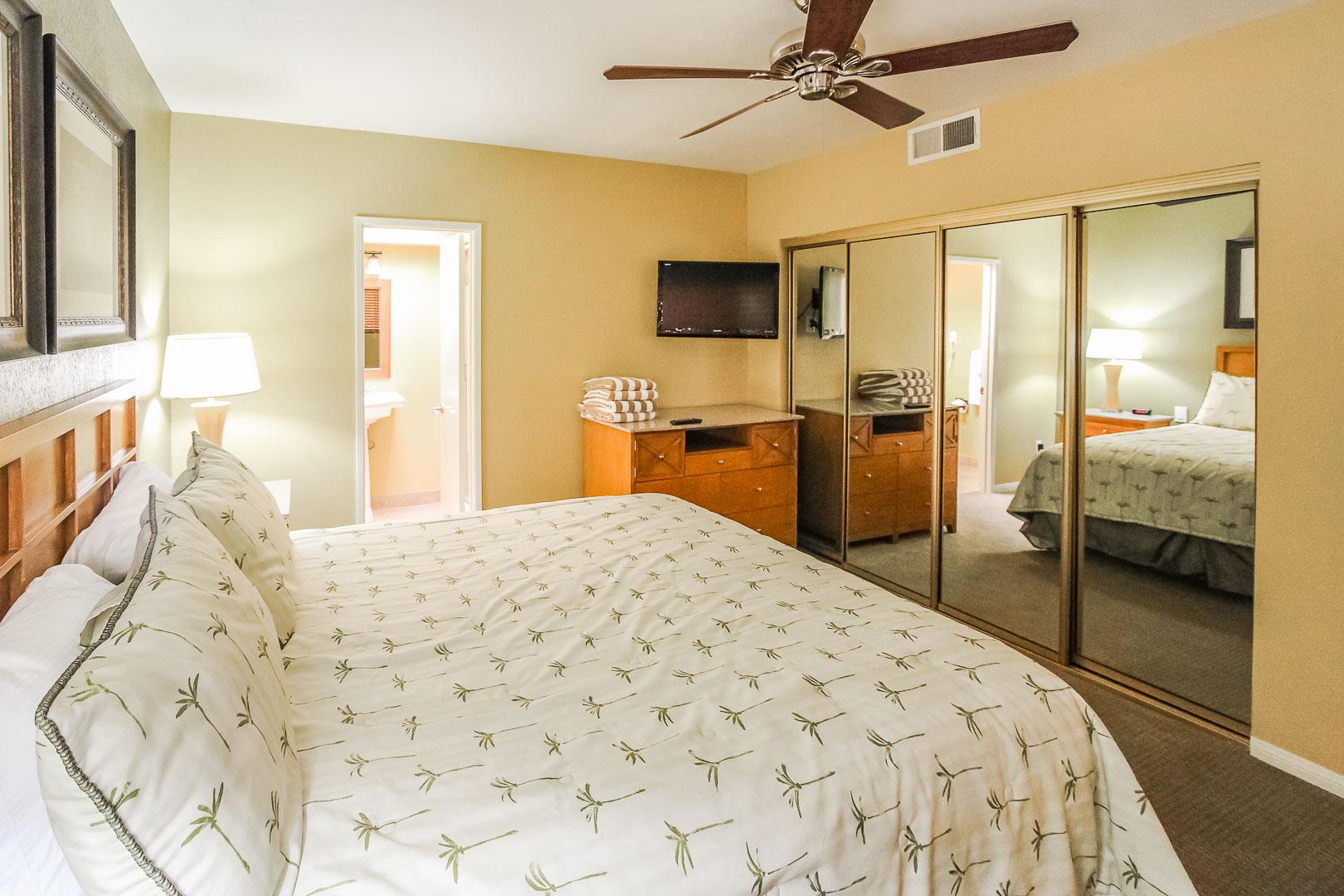 A cozy master bedroom at VRI's Desert Isle Resort in California.