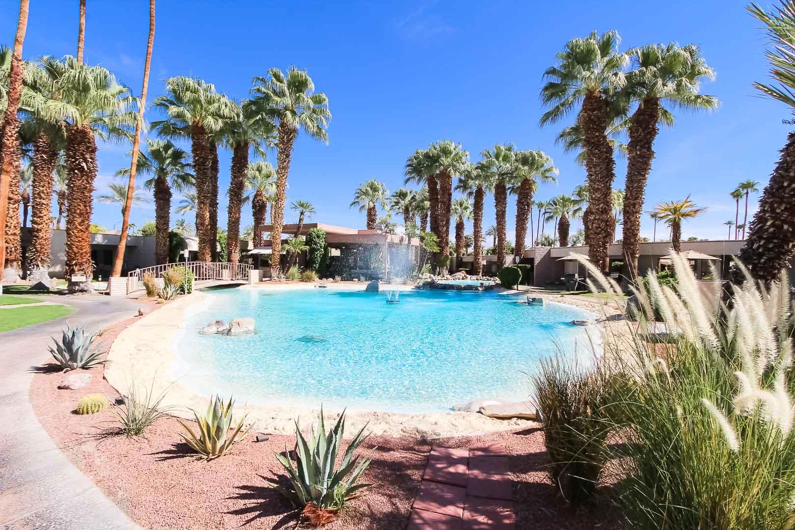 Beautiful palms surrounding the outside view at VRI's Desert Isle Resort in California.
