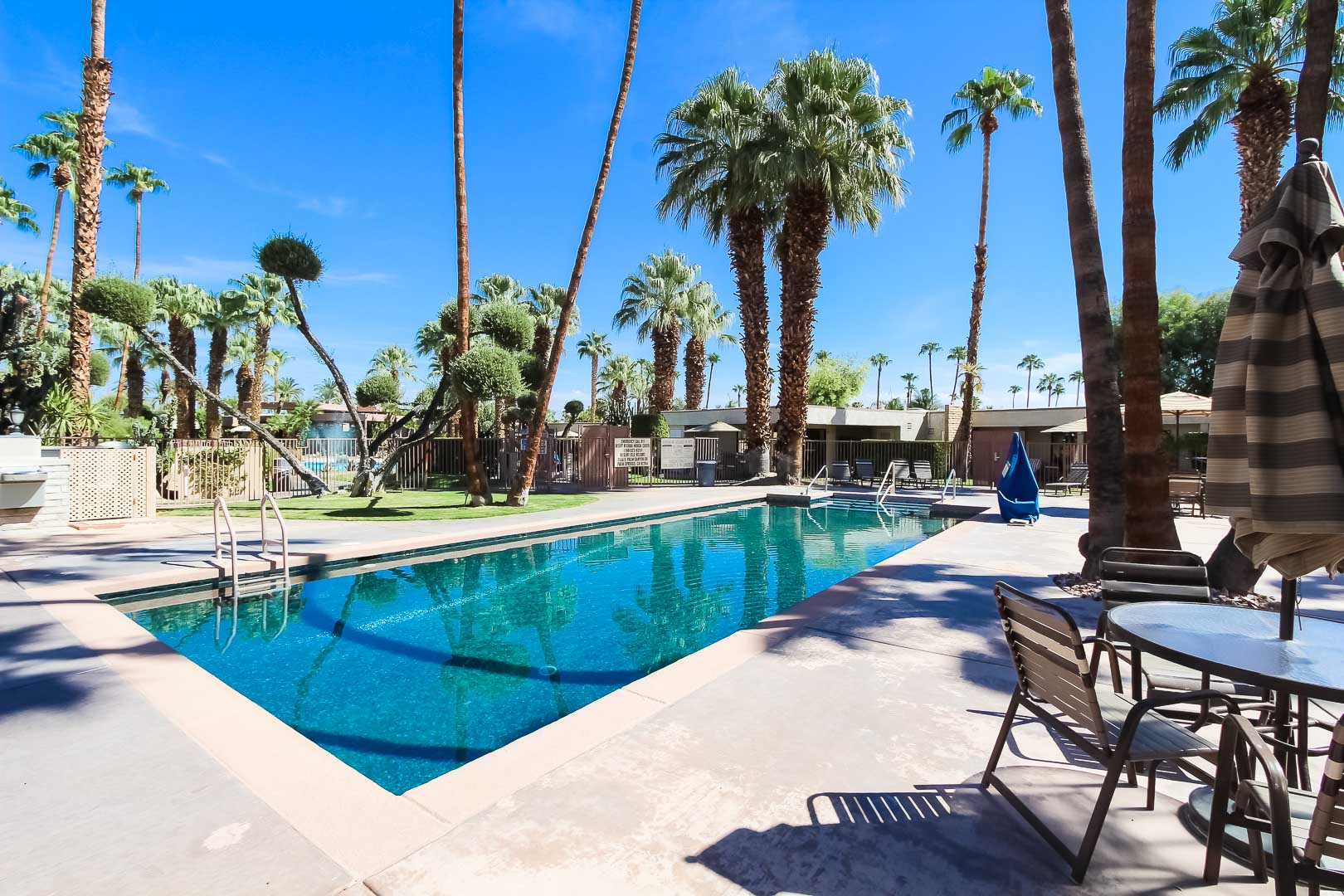 A refreshing outside swimming pool at VRI's Desert Isle Resort in California.