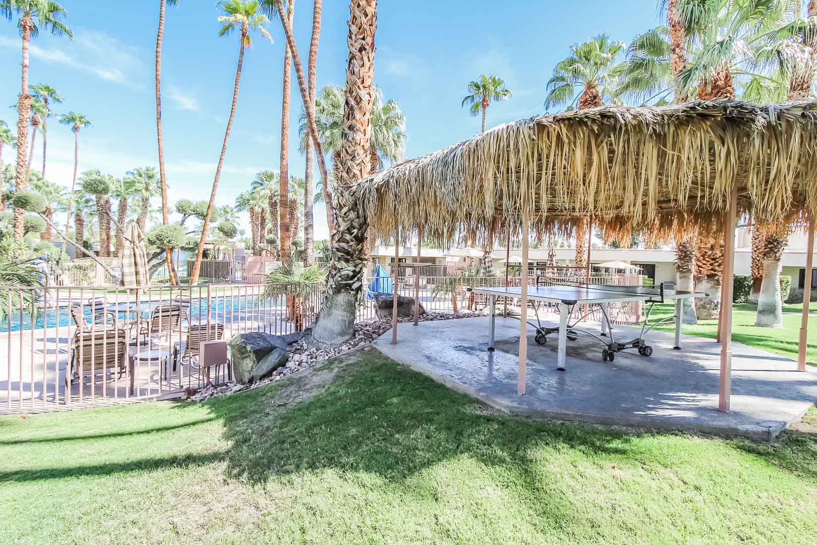 An outside pool and ping pong table at VRI's Desert Isle Resort in California.