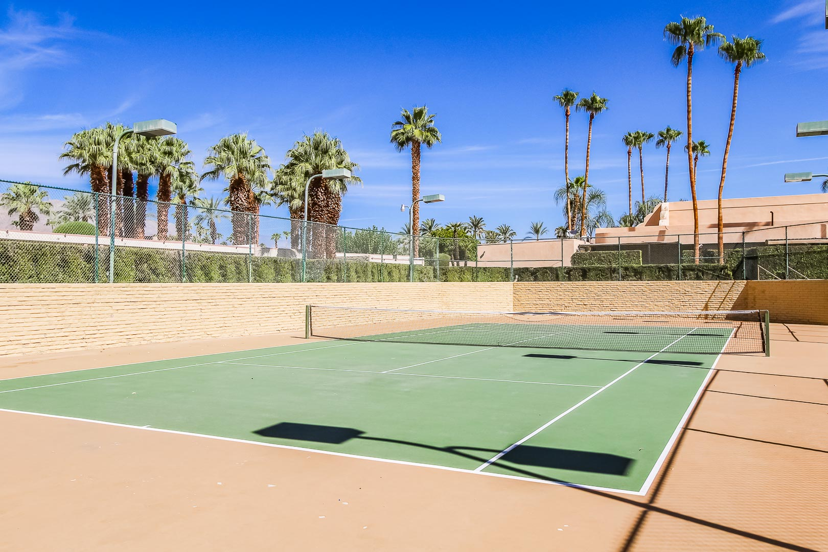 Large outside tennis courts at VRI's Desert Isle Resort in California.